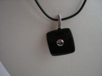 Collier voorzien van zwarte eboniet hanger